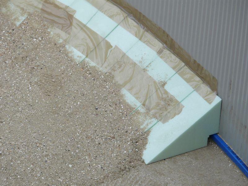 J 39 enterre ma piscine hors sol piscines r alisations for Parpaing polystyrene pour piscine